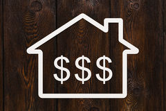 Paper house with dollars sign inside. Abstract conceptual image Royalty Free Stock Photo