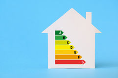 Paper house with energy efficiency chart Stock Image