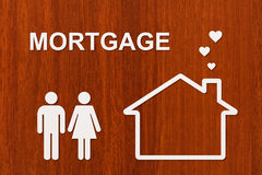 Paper house and family with mortgage text. Conceptual image Royalty Free Stock Photography