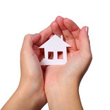 Paper House in Female Hands isolated on White Background Royalty Free Stock Photo