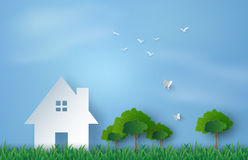 Paper house in the field. Paper art of house in green field and blue sky Royalty Free Stock Images