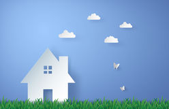 Paper house in the field. Paper art of house in green field and blue sky Stock Photo