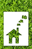 Paper house on fresh grass land. Stock Images