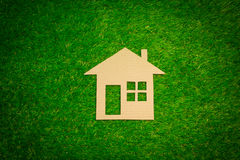 Paper house on the grass. Carton paper house on the grass Stock Images