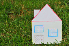 Paper house in the grass. Stock Photography