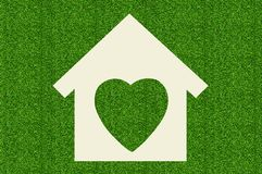 Paper house on green grass Stock Photos