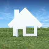 Paper house in the green grass field Royalty Free Stock Photo