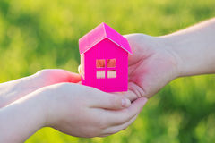 Paper house in hand outdoor. Pink paper house in hand outdoor Royalty Free Stock Photos