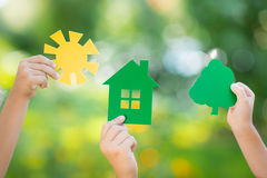 Paper house in hand Stock Image