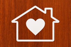 Paper house with heart inside. Housing concept. Abstract conceptual image Stock Photography