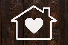 Paper house with heart inside. Housing concept. Abstract conceptual image Royalty Free Stock Photography