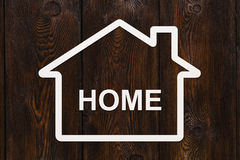Paper house with home text inside. Housing, family concept Royalty Free Stock Photography