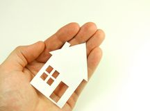 Paper house on human hand Royalty Free Stock Photo