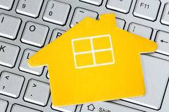 Paper house icon on the computer keyboard Stock Images