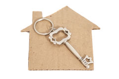 Paper house with key Stock Photo
