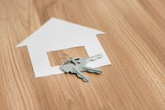 Paper house with a key from the new apartment.  Royalty Free Stock Photos