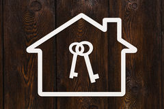 Paper house with keys inside. Abstract conceptual image Stock Photos