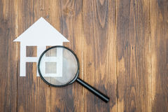 Paper house with Magnifying Glass, House hunting Royalty Free Stock Photos