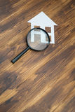 Paper house with Magnifying Glass, House hunting Stock Photos