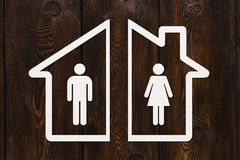 Paper house with man and woman inside. Divorce concept. Abstract conceptual image Stock Photo