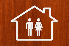 Paper house with man and woman inside. Housing, family concept Royalty Free Stock Photos