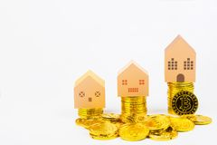 Paper house model toy on Cryptocurrency golden bitcoins coin on Stock Images