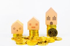 Paper house model toy on Cryptocurrency golden bitcoins coin on Royalty Free Stock Image