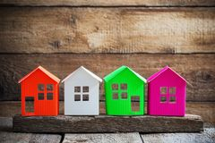 Paper house on old wooden background Royalty Free Stock Image