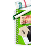 Paper house, Russian money, a pen and a notebook Stock Image