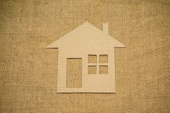 Paper house on sackcloth Royalty Free Stock Images