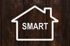 Paper house with smart text inside. Housing, family concept Royalty Free Stock Photography