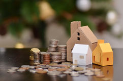 Paper house and stacks of coins standing Royalty Free Stock Photography