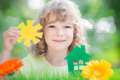 Paper house and sun in hand Royalty Free Stock Images