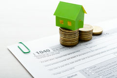Paper house and tax form Stock Image