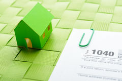 Paper house and tax form Stock Photos
