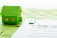 Paper house and tax form Royalty Free Stock Image