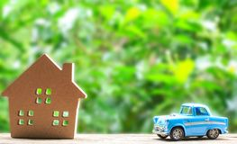 Paper house and toy car on wood Royalty Free Stock Photos