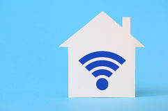 Paper house with wi-fi symbol Stock Photo