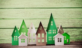 Paper house on  wooden background Stock Photos