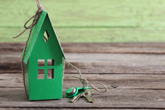 Paper house on  wooden background Stock Images