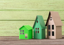 Paper house on  wooden background Royalty Free Stock Photo
