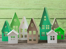 Paper house on  wooden background Royalty Free Stock Photography