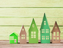 Paper house on wooden background Royalty Free Stock Images