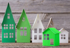 Paper house on wooden background Stock Image