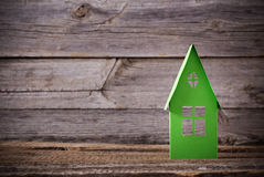 Paper house on wooden background. Paper house on old wooden background Royalty Free Stock Image