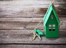 Paper house on wooden background Royalty Free Stock Image