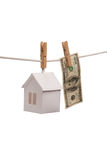 Real estate concept. Paper houses with clothespins, on isolated on white background Royalty Free Stock Image