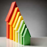 Paper Houses in Energy Label Colors. Energy label homes in the colors of the European standard under dramatic light royalty free stock images