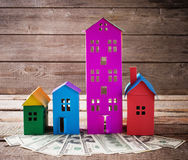 Paper houses over wooden background Royalty Free Stock Photos