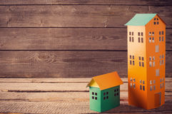 A paper houses  over a wooden background Royalty Free Stock Photography